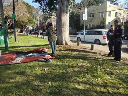 University police say tent must go, so tent comes down.