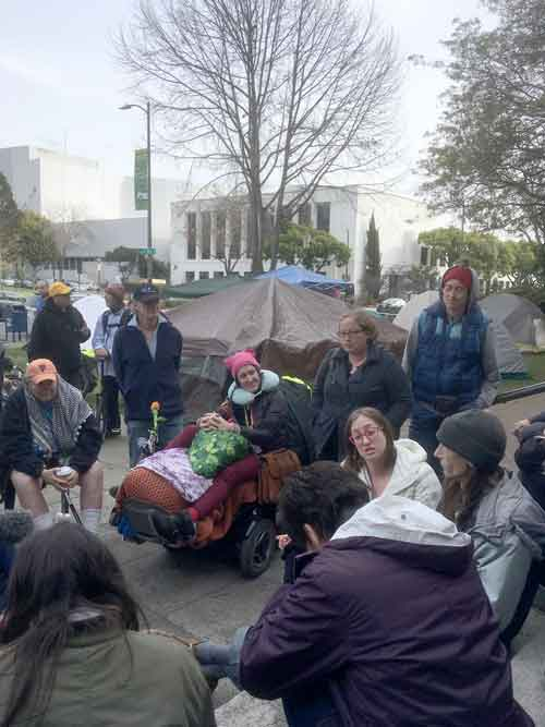 Homeless tent users, including advocates and concerned community members, met in front of Berkeley's Old City Hall with Leilani Farha, United Nations Special Rapporteur on Adequate Housing to discuss their treatment by the City of Berkeley. Farha also visited Oakland and San Francisco for an international human rights report on government response to the housing crisis.