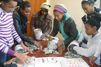 Berkeley High School students count money raised for Haiti relief on Friday, Jan. 22.