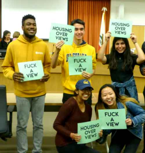 Twice at the Berkeley City Council public hearing on the appeal of the development at 2190 Shattuck, groups of students, including several ASUC officers, smiled and posed for selfies in front of the council dais, displaying their 'Fuck a View' slogan facing supporters of the appeal.