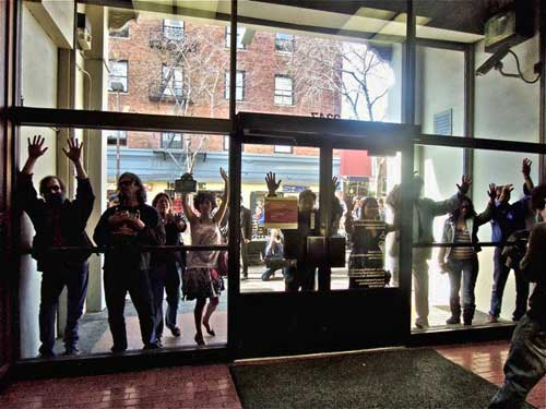 Early closing at BA, Telegraph, Saturday. Protestors are banging on bank windows, making demands. Rev. Billy is seventh from left.