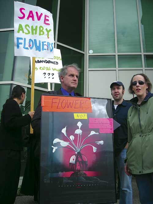 Councilmember Kriss Worthington joins Halcyon Neighborhood Association co-chair Nancy Carleton and Aaron Vance to protest outside Whole Foods Market's Emeryville headquarters Wednesday.