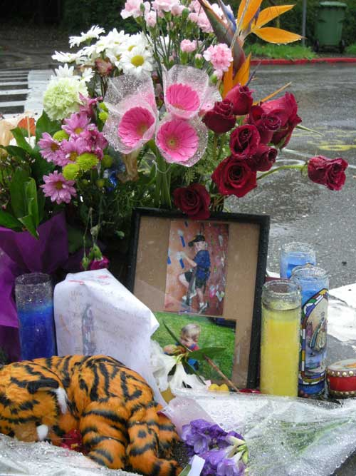 Flowers, photos and stuffed animals have been placed at the intersection of Derby and Warring streets, where Zachary Cruz was struck and killed by a truck Friday.