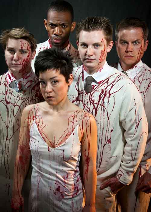 Tamora, Queen of the Goths (Anna Ishida, front) with her lover, Aaron (Reggie White, rear)
