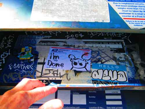 Graffiti can spring up in some surprising places. Such as inside a USPS mailbox…