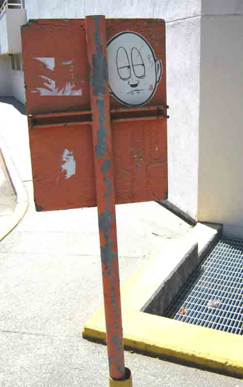"One neighborhood artist I've come to know is a character I call ""Mr. Watchful."" His simple cartoons have placed the blocks near my downtown office under constant, bemused surveillance.