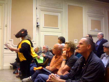 A BRT opponent dressed as a rat gets up to speak during the public hearing as Berkeley resident Scott Tolmie looks on.