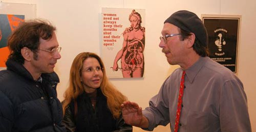 Lincoln Cushing (right), curator of the exhibition speaks with café gallery visitors Margarita Brown and Randy Brown.