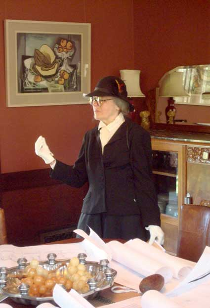 Historian Betty Marvin, in the persona of Julia Morgan, visited the houses on the BAHA Tour answering questions about her work.  Here she discusses the 1905 Kofoid House, with copies of her architectural drawings on hand.