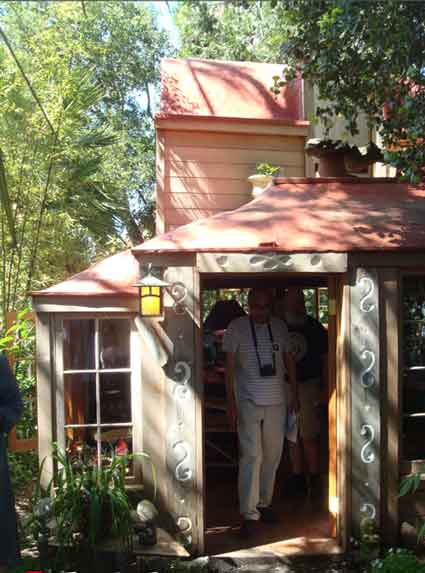 A Hobbit-like two-story cottage was a surprise in a splendid Berkeley garden on the BAHA tour that also featured a chain of three ponds and lush tropic plantings behind an elegant brown shingle.