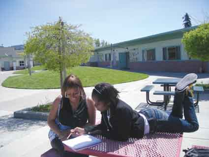 Tanoya Law and Cassandra Irvin ponder a math problem on the B-Tech campus. Law has been accepted into three colleges this fall, and Irvin, a junior, is planning to go to college next fall.
