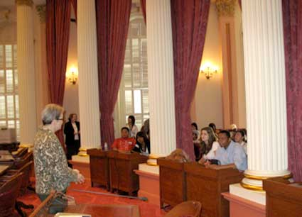 Loni Hancock talks with students in the Senate chambers.