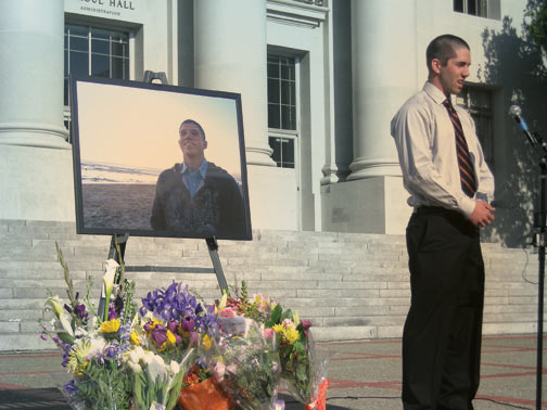 Sigma Pi President Joe Mazzella, roommate of UC Berkeley engineering student Chris Wootton, spoke at Wootton's memorial service on the Sproul Hall steps. Mazzella shaved his head along with his other fraternity brothers on Sunday in honor of Wootton.