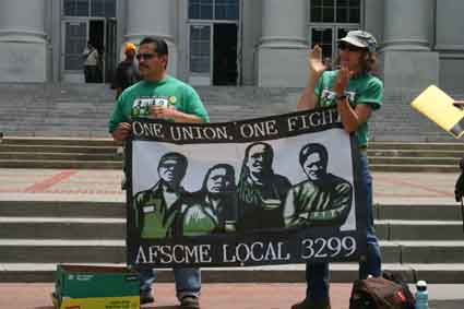AFSCME union workers protest the arrest of Jesus Gutierrez by UCPD officers during a rally at Sproul Plaza Wednesday, May 13.
