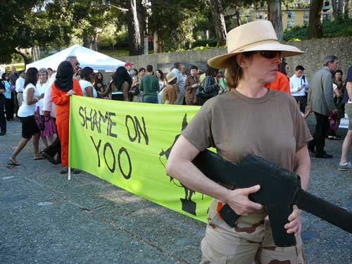 Mary Ervin of Oakland, one of those who demonstrated against John Yoo at U.C. graduation ceremonies, carried a cardboard replica of an M-16 rifle.