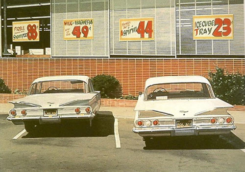 "Robert Bechtle's ""'60 Chevies"" depicting the parking lot of U-Save on University and old Grove, the sight of proposed development that promises to bring back a grocery store to the corner in the form of Trader Joe's."