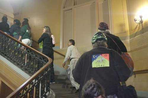 Ten at a time at 10 p.m. ascend to council chambers to protest anti-sit measure.