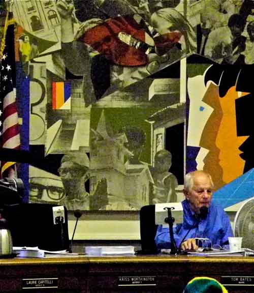 The Mayor presides over the council on Tuesday in front of the Romare Bearden mural, a relic of Berkeley's progressive past.