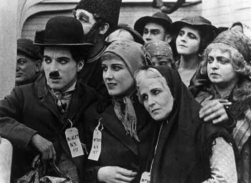 Charlie Chaplin and Edna Purviance in The Immigrant.
