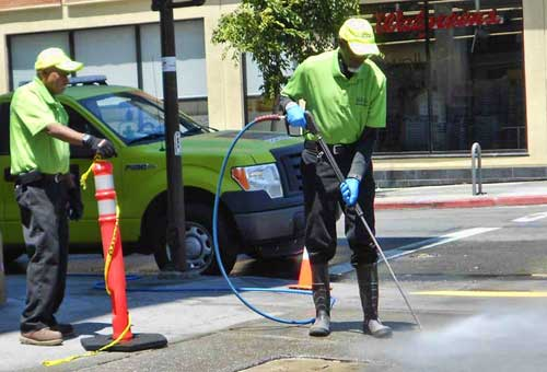 "In spite of our serious drought, the men in green (""Cleaning Ambassadors"" under contract with the Downtown Berkeley Association) power washed the sidewalk at Shattuck and Allston Way for an hour on Sunday, July 13th."