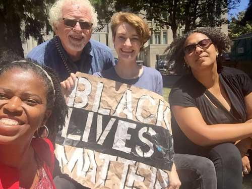 These Berkeleyans were in the group of ten whose entry into Berkeley's city administration building was barred by city employees during business hours last week. L to R: Moni T. Law, Tom Luce, Kyla Whitmore, Nanci Armstrong-Temple
