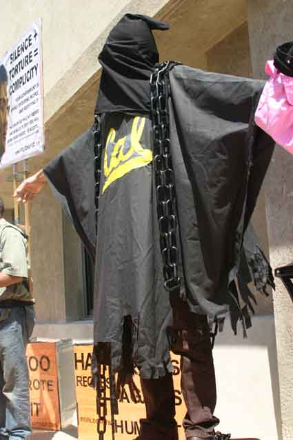 An anti-war activist dressed as an Abu Ghraib prison inmate during a protest outside the UC Berkeley School of Law Monday.