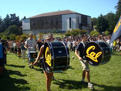 The Cal Band, sans formal uniforms, marched in and played to open the
