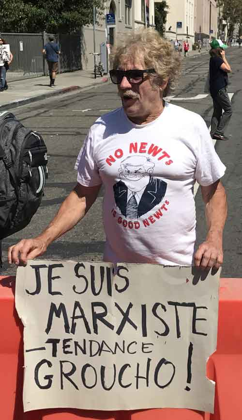 Rick Spaid promoted his own kind of Marxism at the No to Marxism rally with a historic sign he used first in Paris in 1968.