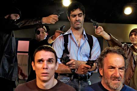 "Padraic (Damien Seperi, center) searches for answers in the death of his beloved cat in the Masquers Playhouse production of ""The Lieutenant of Inishmore."" (bottom Alan Coyne, Avi Jacobson; background Jesse MacKinnon, David Stein, and Dan Kurtz)."