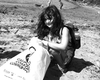 Dorianna Blitt picks up trash at the Berkeley marina Saturday. She was one of nearly 1,000 residents of Berkeley, Albany and Emeryville that showed up for this year's California Coastal Cleanup Day. The statewide event, taking place at more than 400 locations and covering 1,100 miles of California coast, also includes cleanup of creeks, rivers and lakes.