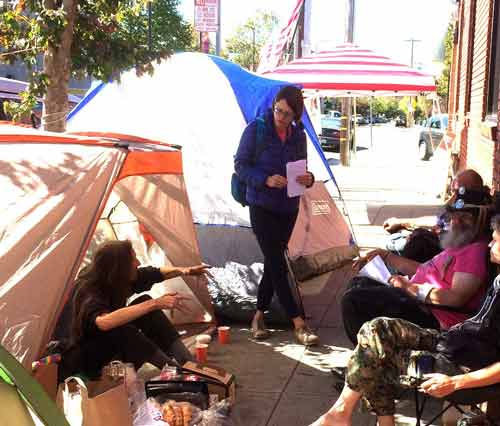 Housing activists speak to a local reporter about the little tent city they set up near the Berkeley Food and Housing Project in early October. Activist Michael Diehl (at right) is shown taking part in the demonstration.