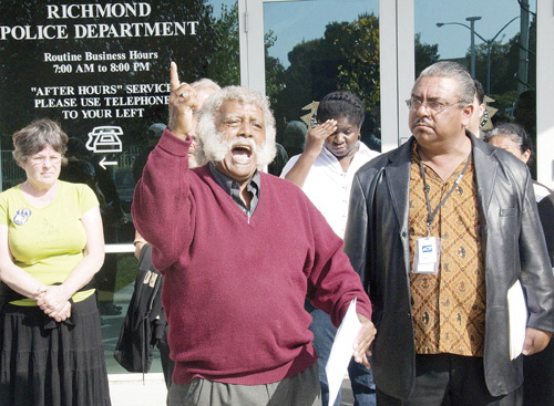 North Richmond Neighborhood House organizer Fred Jackson attacks a Richmond police union flyer as racist against Latinos during a press conference Monday as Andres Soto, right, the conference organizer, listens.