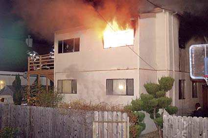 The structure at 1431 67th St. in flames Monday. Photograph by Berkeley Fire Department.