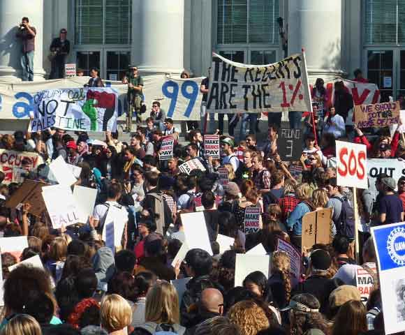 The mid-day rally on Sproul Plaza attracted thousands, many of them with protest signs.  There were short speeches.