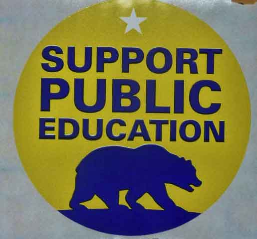 "Cal Associate Vice Chancellor for University Communications Claire Holmes circulated through the crowd passing out ""Support Public Education"" stickers, which many put on (some upside down)."