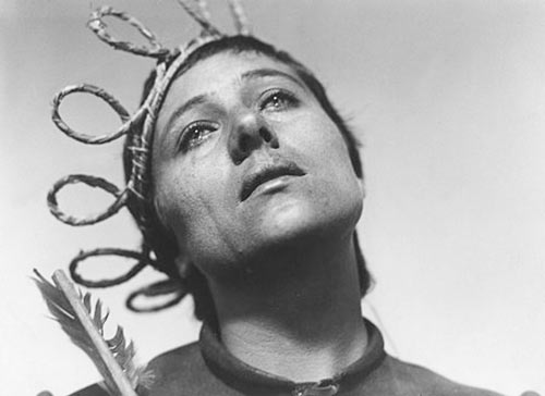 Carl Dreyer's Passion of Joan Arc uses dramatic close-ups and sparse backgrounds to dramatize the confrontations of her trial, juxtaposing her youth and sincerity against the corruption and hostility of her persecutors.