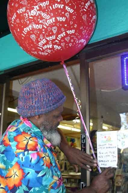 "Balloon artist Don Daniels, of Paper Plus on San Pablo Avenue, posts a sign on the store window: ""Nobody can be uncheered with a balloon ... except the City of Berkeley."""