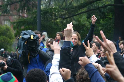 A UC Berkeley faculty member asks students to show their support for the occupiers inside Wheeler Hall