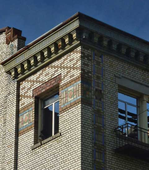 The brick exterior of the Sequoia includes patterned brick and tile insets and an ornate cornice.