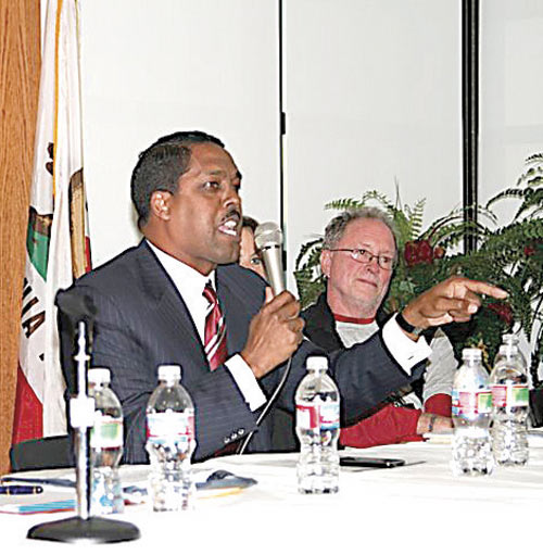 "Nation of Islam Minister Christopher Muhammad of San Francisco speaks at Saturday's Stanley ""Tookie"" Williams Legacy Summit while Bill Ayers looks on."
