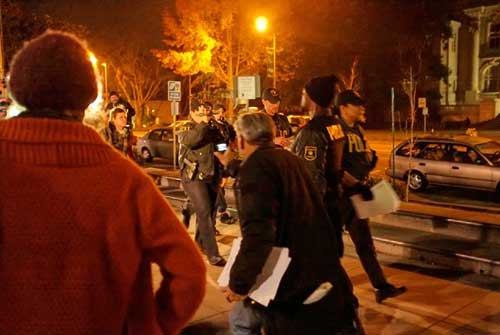 Police march on the periphery of Occupy Berkeley general assembly Wednesday night.