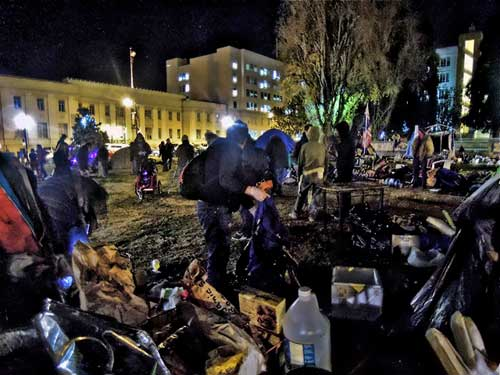 From thick to thin near midnight Wednesday in Civic Center Park, as police warnings clear encampment.