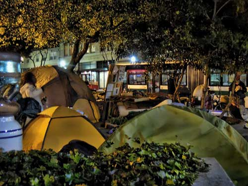 Getting out of Dodge. Campers in Civic Center packing it in, near midnight.