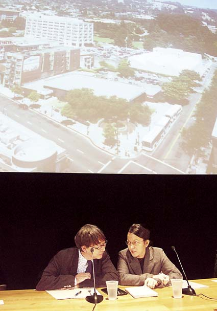 Architect Toyo Ito listens as translator Noriko Takaguchi explains the concerns of the Berkeley residents and officials for the new Berkeley Art Museum/Pacific Film Archive building he is designing on Center Street for UC Berkeley. Photograph by Richard Brenneman.