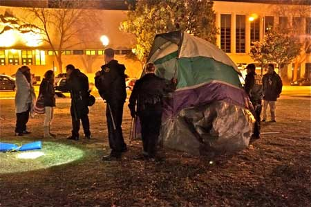 "The officer: ""I'm raising my voice because you're not listening to me."" An Occupier was berating the officer for taking property--after police had given several warnings, over two days, that camping in the park would no longer be tolerated."